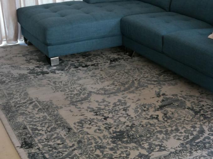 oosters tapijt in beige en petrolblauw