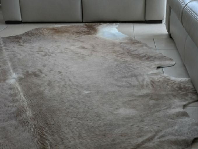Groot koevel als tapijt