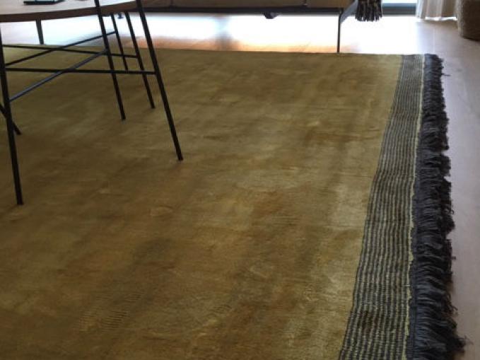 gouden tapijt met franjes